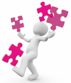 Wit poppetje houdt 4 roze puzzelstukjes in balans